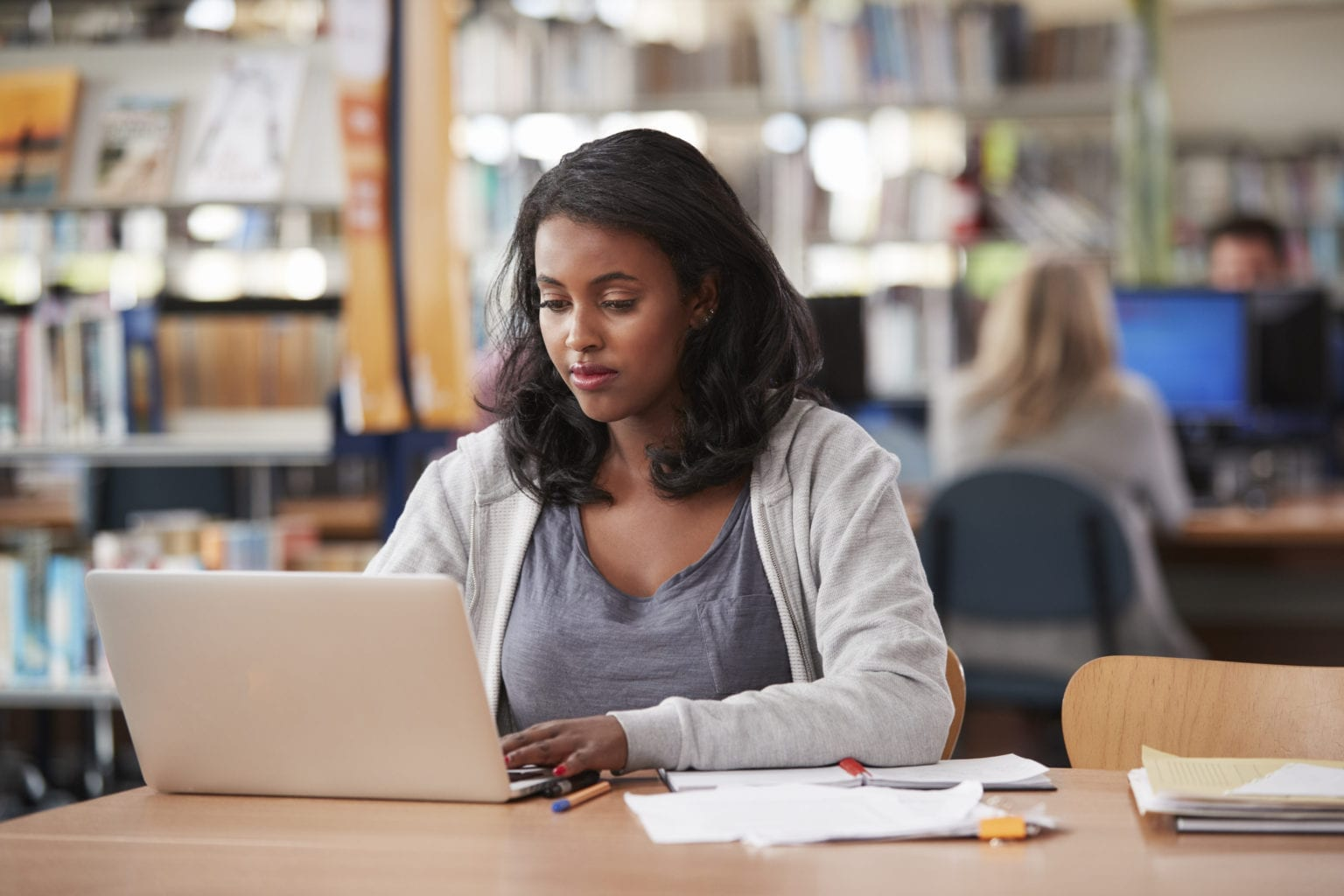 Female student on laptop in library